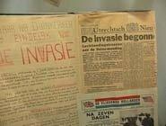 Plakboek waarin de invasie van Normandië wordt besproken